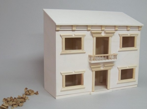 Pasos iniciales para decorar tu casa de muñecas de madera