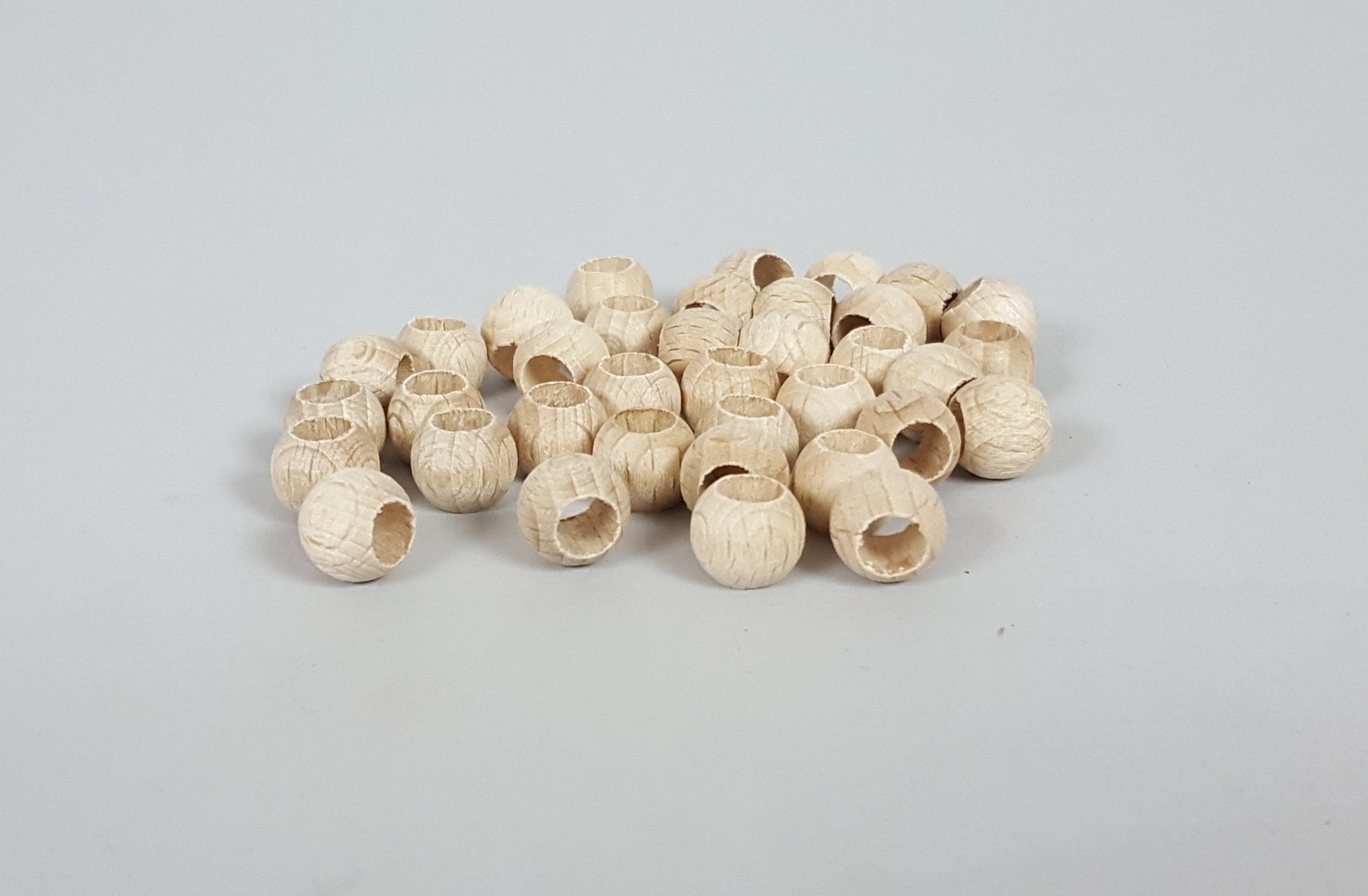 Wooden balls Ø10 mm. w/T.P.6mm. / 100 pcs.